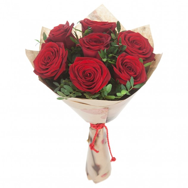 Bouquet of 7 red roses in craft with herbs
